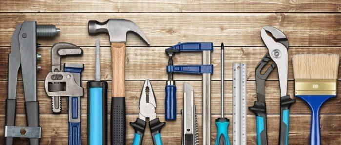 Various carpentry, repairing, DIY tools on wooden background